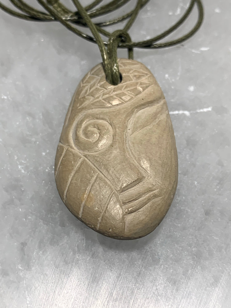 Hand Carved Stone Pendant with Face