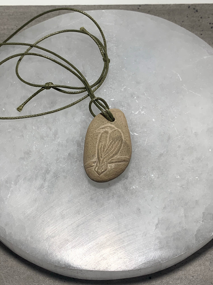 Hand Carved Stone Pendant with Bird