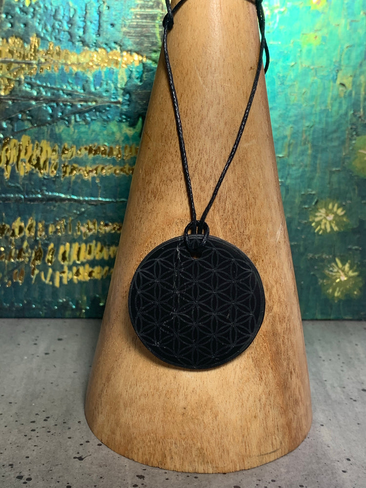 Shungite Pendant with Flower of Life Design