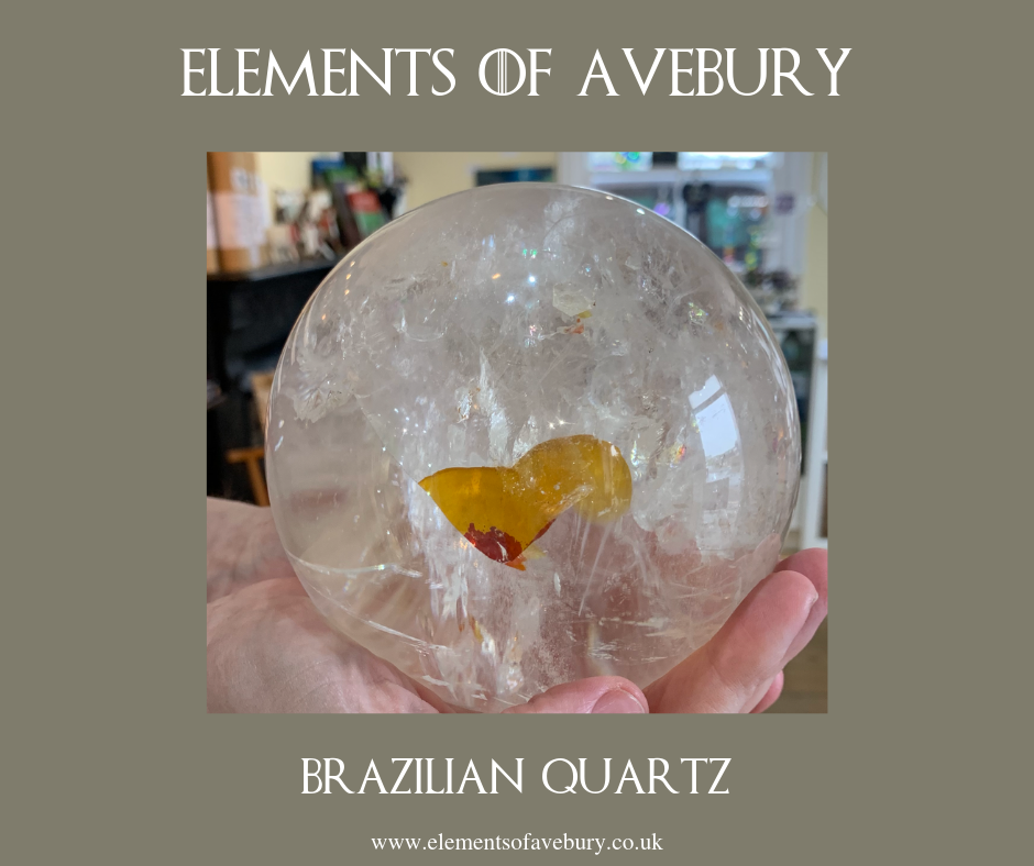 Brazilian Quartz Crystal Sphere with Infusion