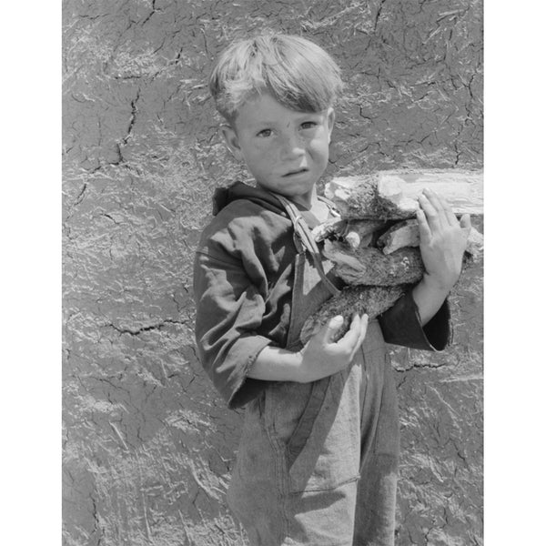 1940 Spanish-American boy with an armful of wood. Chamisal, New Mexico H05