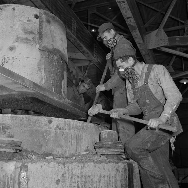 1943 Tending a rock crusher at a large zinc concentrator H28