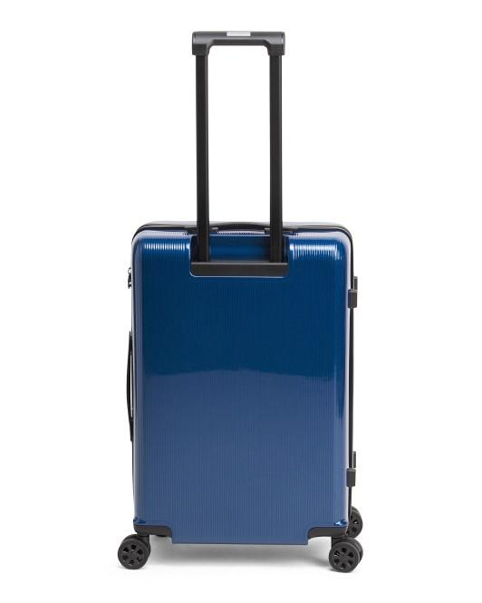 Discovery Adventures 24 Expandable Hardside 4 Wheel Spinner Luggage Blue