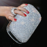 Diamond-look rhinestone studded evening bag. Hard shell case with ring clasp and chain handle.