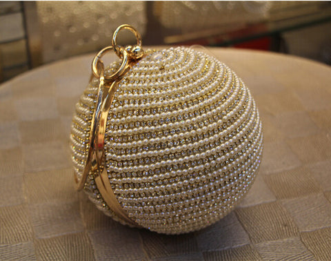 Elegant and quirky Pearl shaped clutch purse. Choose your look with 9 variations.