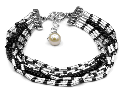Sterling Silver Black And White Hammered Bracelet With Hematite Stones.