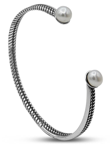 Sterling silver cuff bracelet with two classic fresh water pearls.