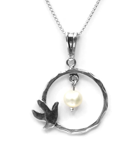 Sterling silver necklace with a dove of peace and a pearl.