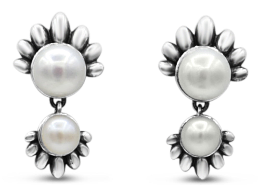 Stunning sterling silver stud earrings with white pearls
