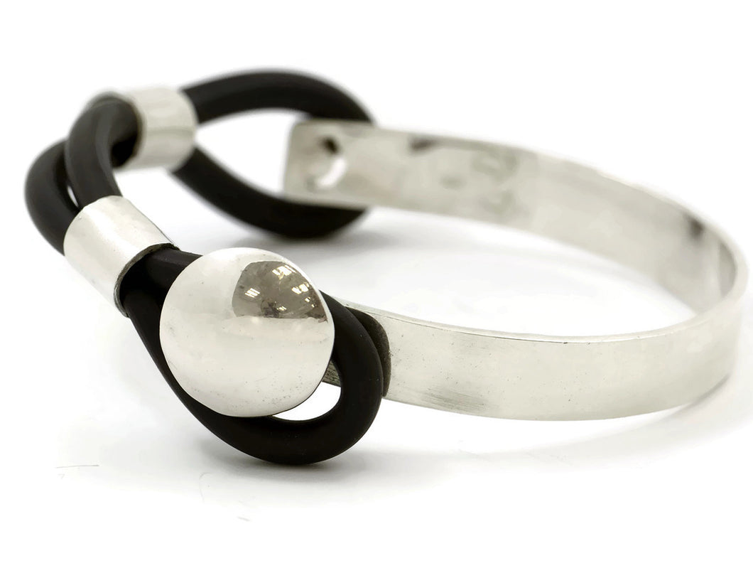 Sterling silver unisex bracelet with rubber loops.