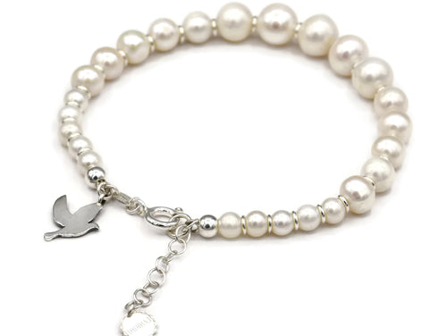 Silver and freshwater pearls bracelet with a silver dove .