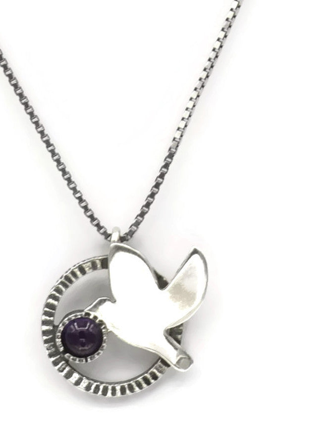 Sterling silver necklace with a dove and an amethyst stone.