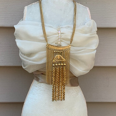 Layers of vintage chain with a pagoda pendant in the center.