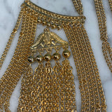 Close up of pagoda chain pendant.