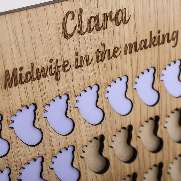 Midwife in the making board - The Bespoke Workshop