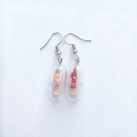 Miniature People Pill Capsule Earrings