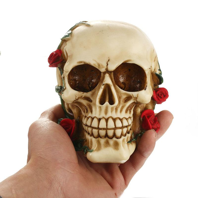 Biting Red Roses Human Skull Statue Sculpture - Skullflow