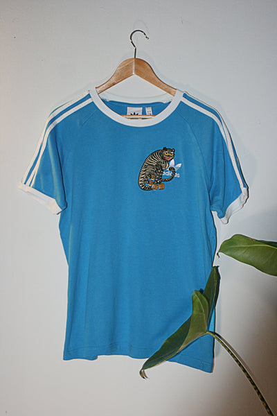 Sky Blue Retro Adidas 90s t-shirt upcycled with cloh tiger embroidery