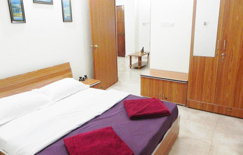 Stay at Holiday Apartments Baga (Goa): Fully Furnished 1BHK/2BHK AC Holiday Apartments, Swimming pool, Modern kitchen with all necessary cooking appliances & More!
