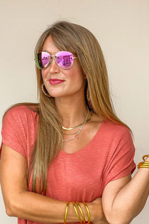 model wearing Heat Wave pink gold sunglasses