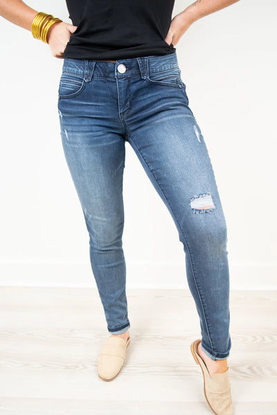 "a woman wearing a distressed pair of Democracy ""Ab""solution jeans"