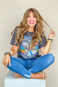 woman wearing a cute women's graphic tee and jeans