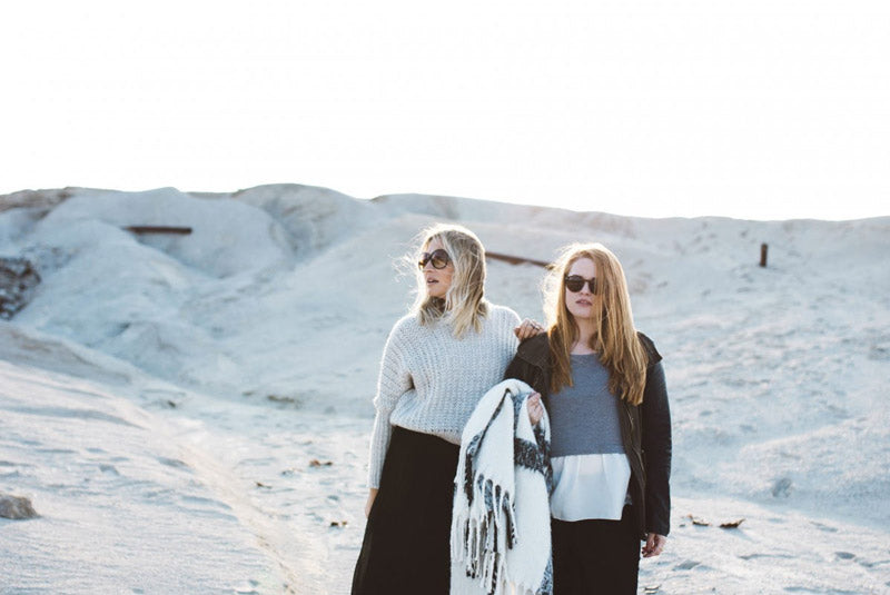 two girls wearing minimalist winter fashion