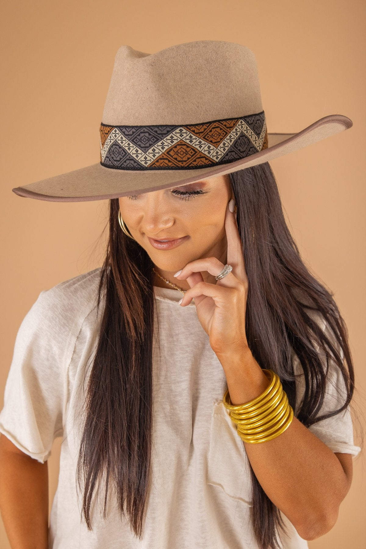 woman modeling design inspired wool rancher hat