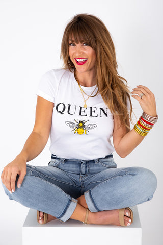 """a woman wearing a white tee with the word """"Queen"""" and a bee image"""