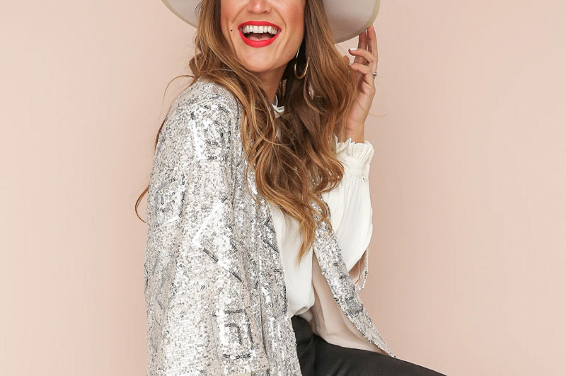 woman wearing a sequined boutique cardigan