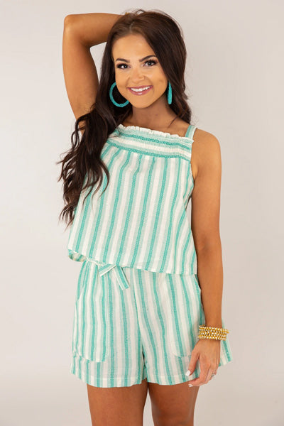 A woman wearing a striped two piece set outfit.