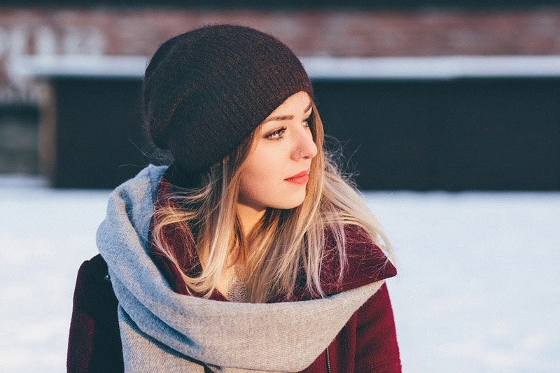 a woman wearing beanie and scarf winter accessories
