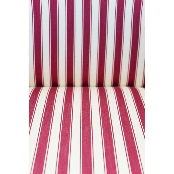 Close up of the red and white striped fabric on antique parlor chairs.