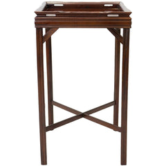 Side view of an antique mahogany end table with a simple fluted design and a cross bar between the legs.