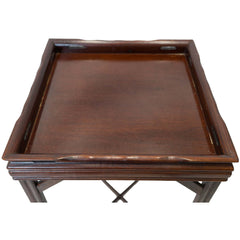 Top view of a square antique mahogany end table.
