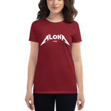 Young female wearing a Aloha Tribe Hawaii T-shirt that has a Hawaii themed graphic logo on the front.