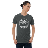 Young male wearing a Aloha Tribe T-shirt that has a Hawaii themed graphic logo on the front.