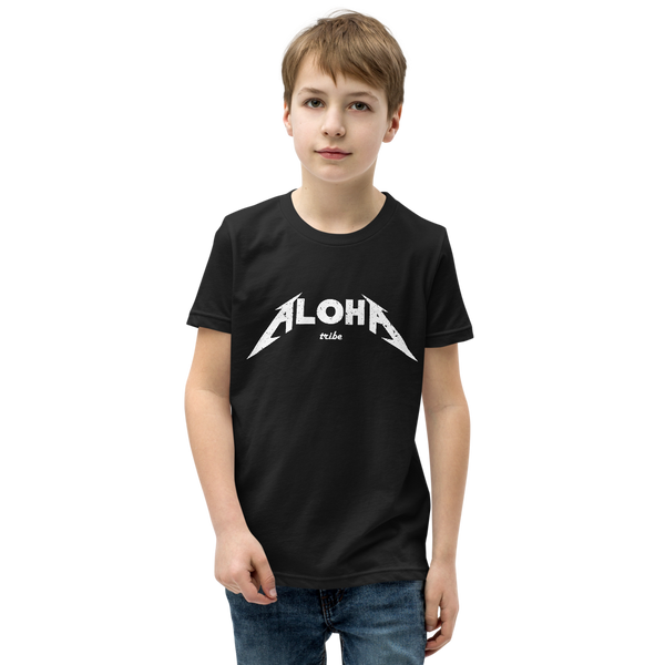 Preteen model wearing a Aloha Tribe Hawaii T-shirt that has a Hawaii themed graphic logo on the front.