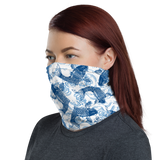 Young model wearing a neck gaiter mask that has a Hawaii urban street themed graphic logo on the front.