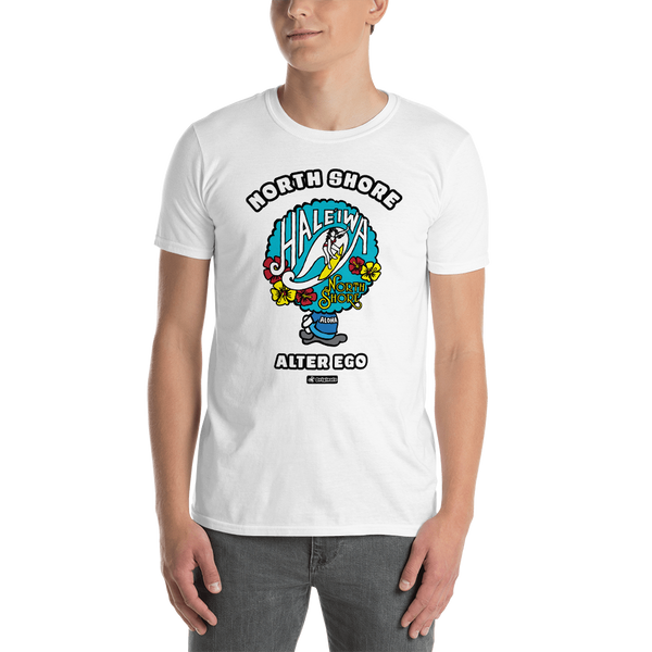 Young male adult wearing a Alter Ego Hawaii T-shirt that has a Hawaii themed graphic logo on the front.