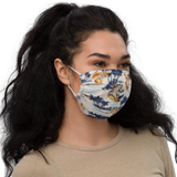 Young model wearing a Aloha Tribe Hawaii face mask that has a Hawaii themed graphic print.