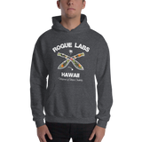 Young model wearing a Rogue Labs Hawaii unisex hoodie that has a urban street themed graphic logo on the front.