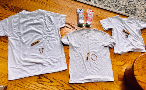Kids White tshirts that are becoming tie dyed shirts for 4th of July DIY crafts