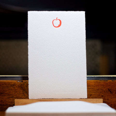 letterpress printed flat note with apple design