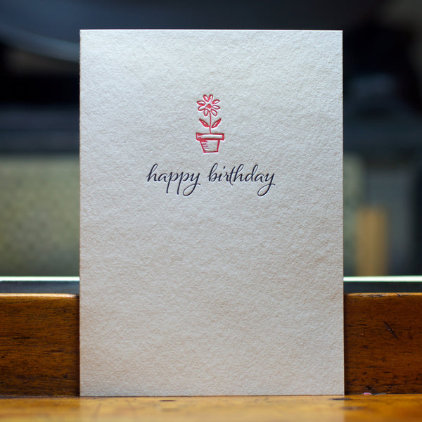 happy birthday card with single pink flower in pot