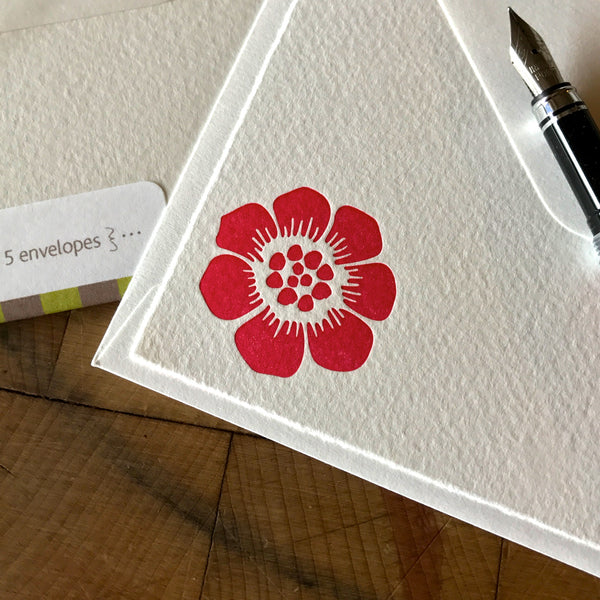 close up on graphic flower letterpress note card in pink