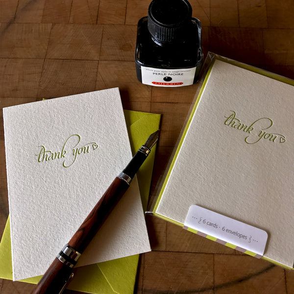 lifestyle image of letterpress thank you card in dark chartreuse
