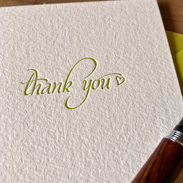 close up of letterpress thank you card in dark chartreuse