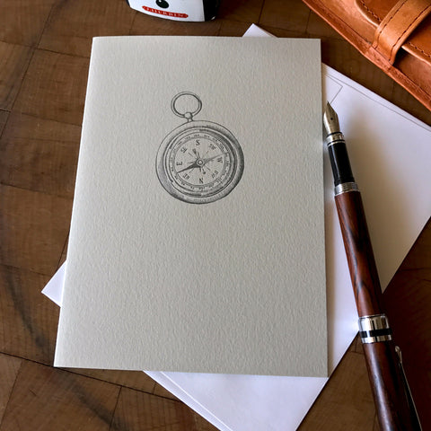 lifestyle image of sorry letterpress card with compass for missed directions