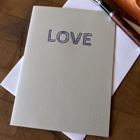 lifestyle image of love letterpress card